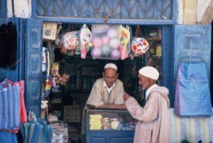 Men chatting at shop, Essaouira, Morocco